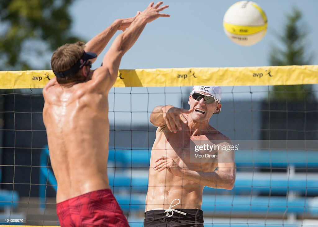 <a gi-track='captionPersonalityLinkClicked' href=/galleries/search?phrase=Jake+Gibb&family=editorial&specificpeople=568384 ng-click='$event.stopPropagation()'>Jake Gibb</a> (R) spikes the ball against Clay Paulin (L) at the 2014 AVP Cincinnati Open on August 29, 2014 at the Lindner Family Tennis Center in Cincinnati, Ohio.