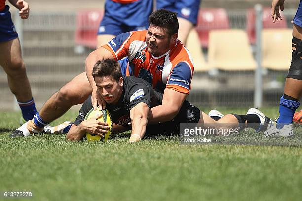 Jake Gordon of the Eagles scores a try during the round seven NRC match between the Western Sydney Rams and the NSW Country Eagles at Concord Oval on...