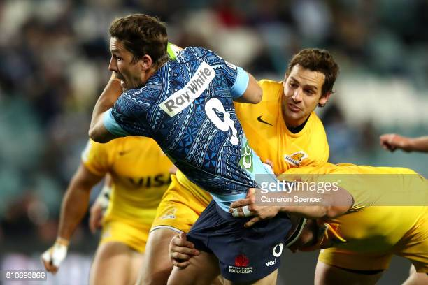 Jake Gordon of the Waratahs is tackled during the round 16 Super Rugby match between the Waratahs and the Jaguares at Allianz Stadium on July 8 2017...