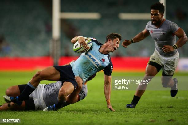 Jake Gordon of the Waratahs is tackled during the round nine Super Rugby match between the Waratahs and the Kings at Allianz Stadium on April 21 2017...