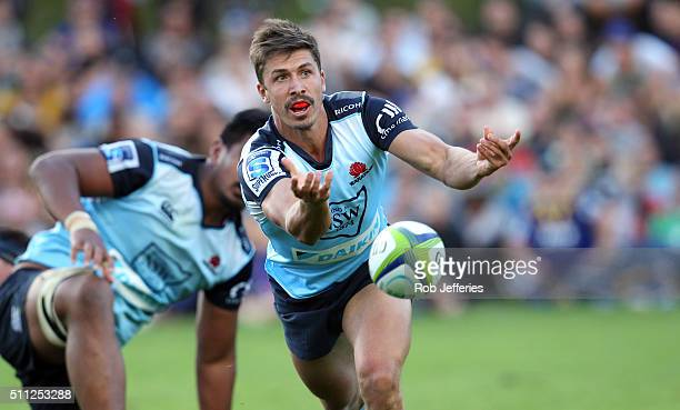 Jake Gordon of the Waratahs passes the ball during the Super Rugby trial match between the Highlanders and the Waratahs at the Queenstown Recreation...