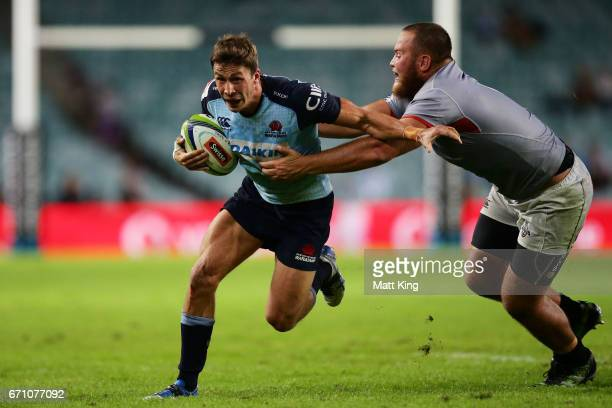 Jake Gordon of the Waratahs takes on the defence during the round nine Super Rugby match between the Waratahs and the Kings at Allianz Stadium on...