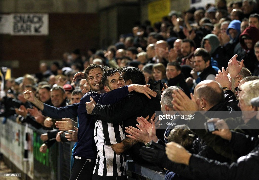 Jake Gosling of Dorchester Town celebrates the win with fans during the FA Cup with Budweiser 1st Round match between Dorchester Town and Plymouth Argyle at The Avenue Stadium on November 4, 2012 in Dorchester, England.