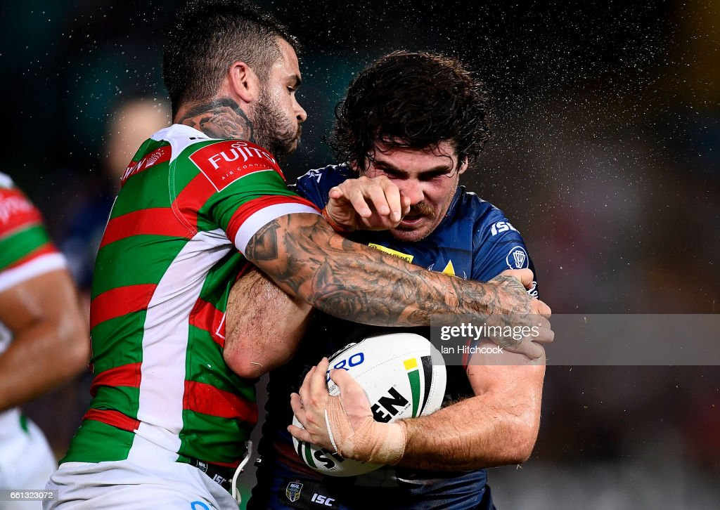 Jake Granville of the Cowboys is tackled by Adam Reynolds of the Rabbitohs during the round five NRL match between the North Queensland Cowboys and the South Sydney Rabbitohs at 1300SMILES Stadium on March 31, 2017 in Townsville, Australia.