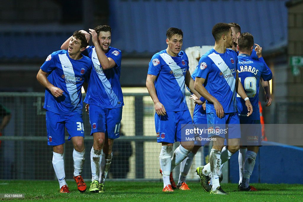 Jake Gray (1st L) of Hartlepool United celebrates scoring his team's first goal with his team mates during the Emirates FA Cup third round match between Hartlepool United and Derby County at Victoria Park on January 9, 2016 in Hartlepool, England.