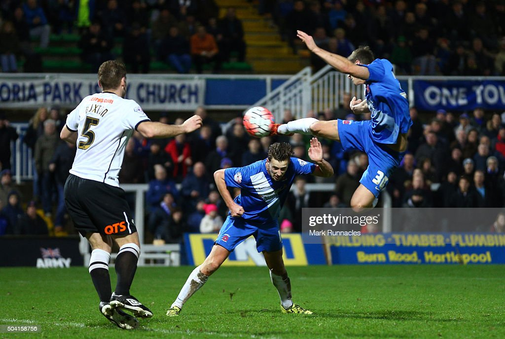 Jake Gray (R) of Hartlepool United scores his team's first goal during the Emirates FA Cup third round match between Hartlepool United and Derby County at Victoria Park on January 9, 2016 in Hartlepool, England.