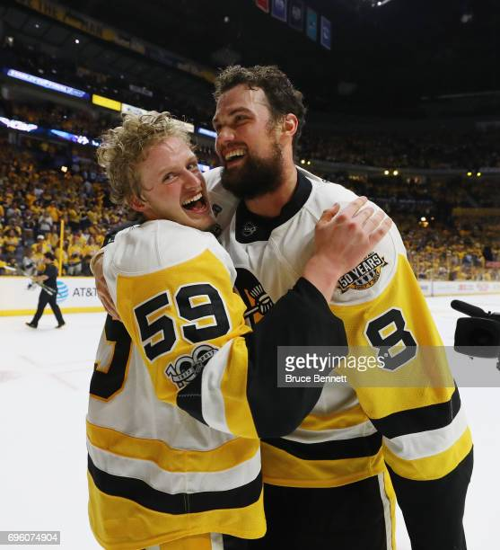 Jake Guentzel and Brian Dumoulin of the Pittsburgh Penguins celebrate their Stanley Cup winning victory over the Nashville Predators in Game Six of...