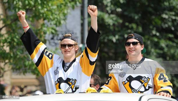 Jake Guentzel and Conor Sheary of the Pittsburgh Penguins ride in the Victory Parade and Rally on June 14 2017 in Pittsburgh Pennsylvania
