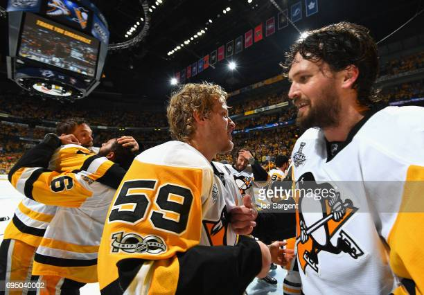 Jake Guentzel and Ron Hainsey celebrate after the Penguins defeated the Nashville Predators 20 to win Game Six of the 2017 NHL Stanley Cup Final at...