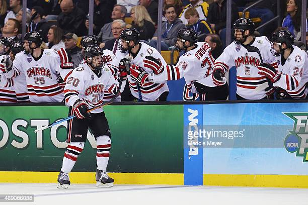 Jake Guentzel of the NebraskaOmaha Mavericks is congratulated by teammates after scoring against the Providence Friars during the third period of the...