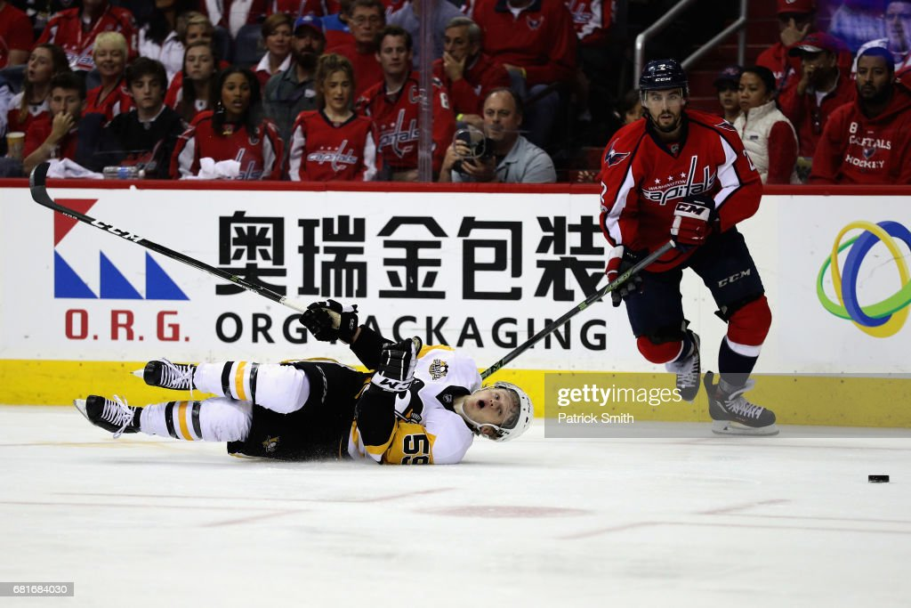 Jake Guentzel #59 of the Pittsburgh Penguins and Matt Niskanen #2 of the Washington Capitals go after the puck in the second period in Game Seven of the Eastern Conference Second Round during the 2017 NHL Stanley Cup Playoffs at Verizon Center on May 10, 2017 in Washington, DC.