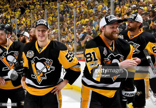 Jake Guentzel of the Pittsburgh Penguins and Phil Kessel of the Pittsburgh Penguins celebrate after defeating the Ottawa Senators 32 in overtime in...
