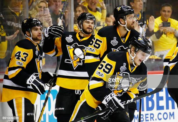 Jake Guentzel of the Pittsburgh Penguins celebrates after scoring a goal during the first period in Game Two of the 2017 NHL Stanley Cup Final...