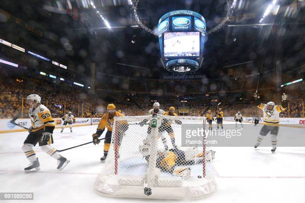 Jake Guentzel of the Pittsburgh Penguins celebrates after scoring a first period goal against Pekka Rinne of the Nashville Predators in Game Three of...
