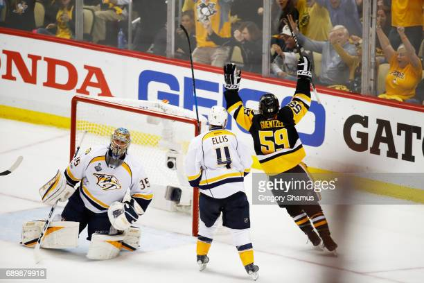 Jake Guentzel of the Pittsburgh Penguins celebrates his goal as Pekka Rinne of the Nashville Predators looks on during the third period in Game One...