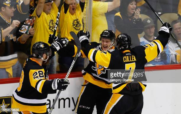 Jake Guentzel of the Pittsburgh Penguins celebrates his goal with teammates during the third period against the Nashville Predators in Game One of...