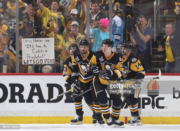 Jake Guentzel of the Pittsburgh Penguins celebrates his goal with teammates during the first period of Game Two of the 2017 NHL Stanley Cup Final...