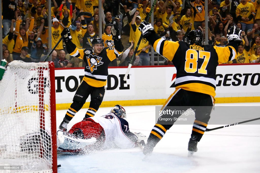 Jake Guentzel #59 of the Pittsburgh Penguins celebrates his second period goal with Sidney Crosby #87 while playing the Columbus Blue Jackets in Game Two of the Eastern Conference First Round during the 2017 NHL Stanley Cup Playoffs at PPG Paints Arena on April 14, 2017 in Pittsburgh, Pennsylvania.