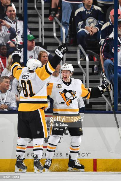 Jake Guentzel of the Pittsburgh Penguins celebrates his third period goal with teammate Phil Kessel of the Pittsburgh Penguins in Game Three of the...