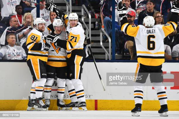 Jake Guentzel of the Pittsburgh Penguins celebrates his third period goal with Phil Kessel Evgeni Malkin and Trevor Daley of the Pittsburgh Penguins...