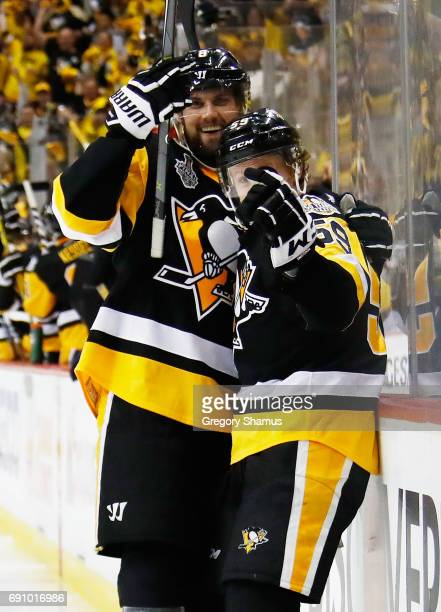 Jake Guentzel of the Pittsburgh Penguins celebrates with Brian Dumoulin after scoring a goal during the third period in Game Two of the 2017 NHL...