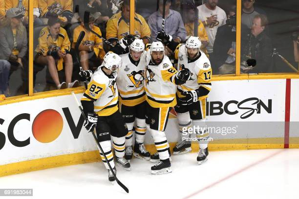 Jake Guentzel of the Pittsburgh Penguins celebrates with teammates after scoring a first period goal against Pekka Rinne of the Nashville Predators...