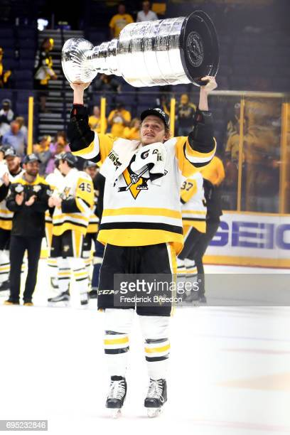 Jake Guentzel of the Pittsburgh Penguins celebrates with the Stanley Cup trophy after defeating the Nashville Predators 20 in Game Six of the 2017...