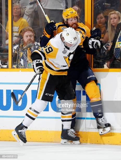 Jake Guentzel of the Pittsburgh Penguins checks James Neal of the Nashville Predators during Game Six of the 2017 NHL Stanley Cup Final at...