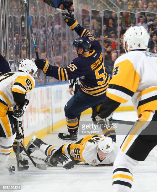 Jake Guentzel of the Pittsburgh Penguins collides with Rasmus Ristolainen of the Buffalo Sabres during an NHL game at the KeyBank Center on March 21...