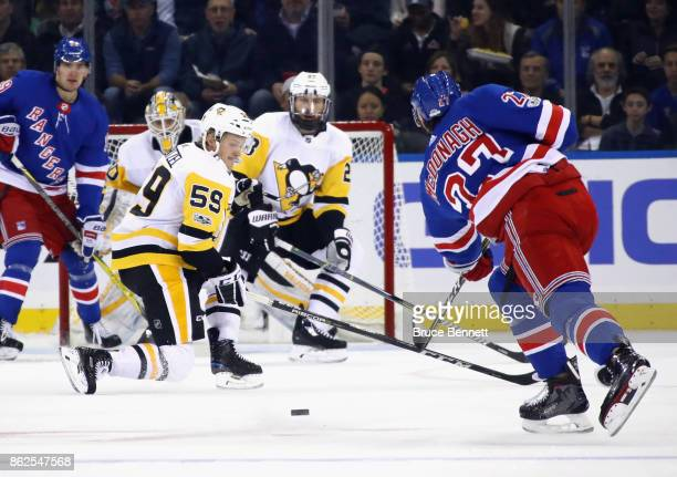 Jake Guentzel of the Pittsburgh Penguins drops to a knee to block a shot by Ryan McDonagh of the New York Rangers during the first period at Madison...