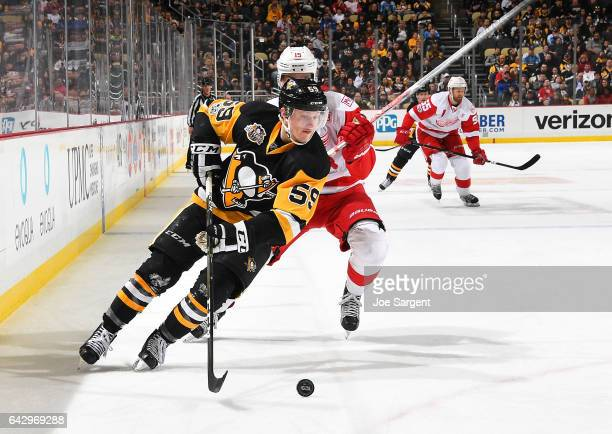 Jake Guentzel of the Pittsburgh Penguins handles the puck against the Detroit Red Wings at PPG Paints Arena on February 19 2017 in Pittsburgh...