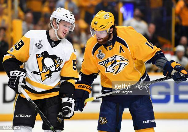 Jake Guentzel of the Pittsburgh Penguins has words with James Neal of the Nashville Predators during the second period of Game Six of the 2017 NHL...