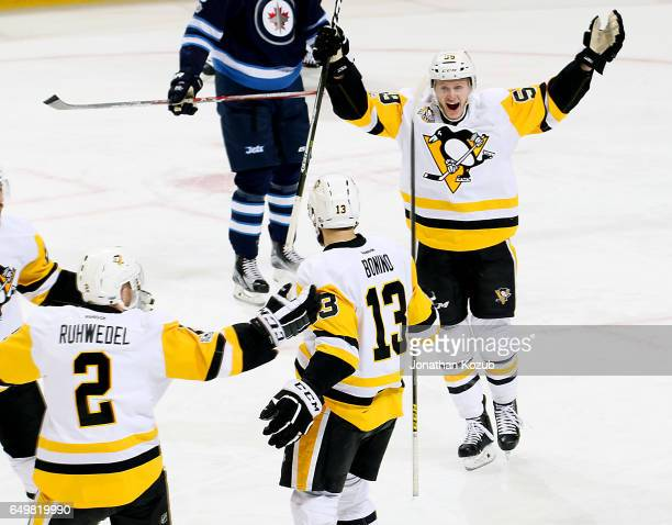 Jake Guentzel of the Pittsburgh Penguins is all smiles as he joins teammates Chad Ruhwedel and Nick Bonino to celebrate a first period goal against...