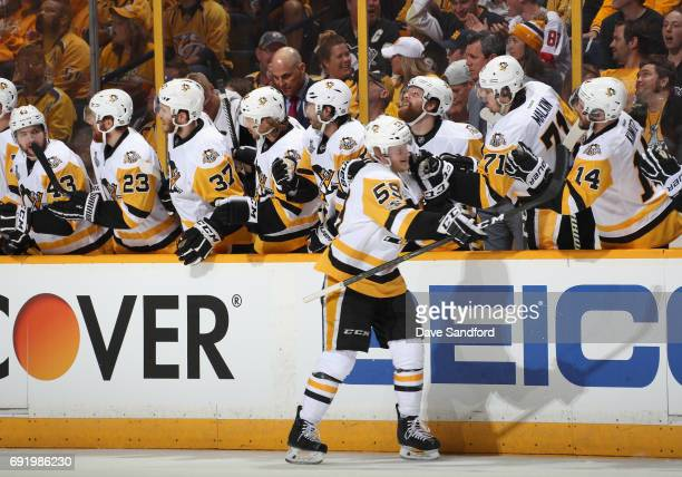 Jake Guentzel of the Pittsburgh Penguins is congratulated by teammates after his first period goal against the Nashville Predators in Game Three of...