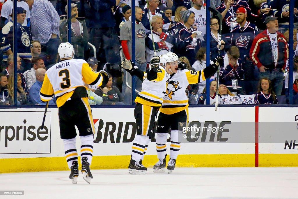 Jake Guentzel #59 of the Pittsburgh Penguins is congratulated by Sidney Crosby #87 after scoring the game-winning goal against the Columbus Blue Jackets in overtime in Game Three of the Eastern Conference First Round during the 2017 NHL Stanley Cup Playoffs on April 16, 2017 at Nationwide Arena in Columbus, Ohio. Pittsburgh defeated Columbus 5-4 in overtime. Pittsburgh leads the series 3-0.