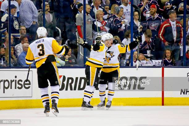 Jake Guentzel of the Pittsburgh Penguins is congratulated by Sidney Crosby after scoring the gamewinning goal against the Columbus Blue Jackets in...