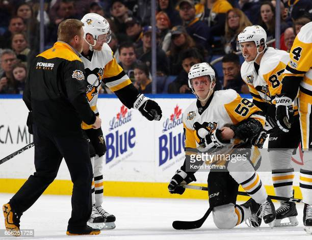 Jake Guentzel of the Pittsburgh Penguins is injured after being hit by Rasmus Ristolainen of the Buffalo Sabres during the first period at the...