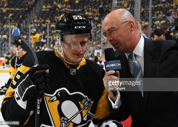 Jake Guentzel of the Pittsburgh Penguins is interviewed by Pierre McGuire prior to the game agains the St Louis Blues at PPG Paints Arena on October...