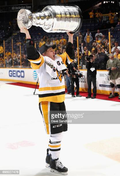 Jake Guentzel of the Pittsburgh Penguins lifts the Stanley Cup after the Penguins defeated the Predators 20 to win the 2017 NHL Stanley Cup Final at...