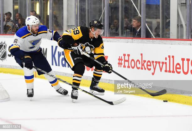 Jake Guentzel of the Pittsburgh Penguins moves the puck in front of Joel Edmundson of the St Louis Blues at UPMC Lemieux Sports Complex on September...