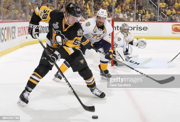 Jake Guentzel of the Pittsburgh Penguins plays against Roman Josi of the Nashville Predators during the second period of Game Five of the 2017 NHL...