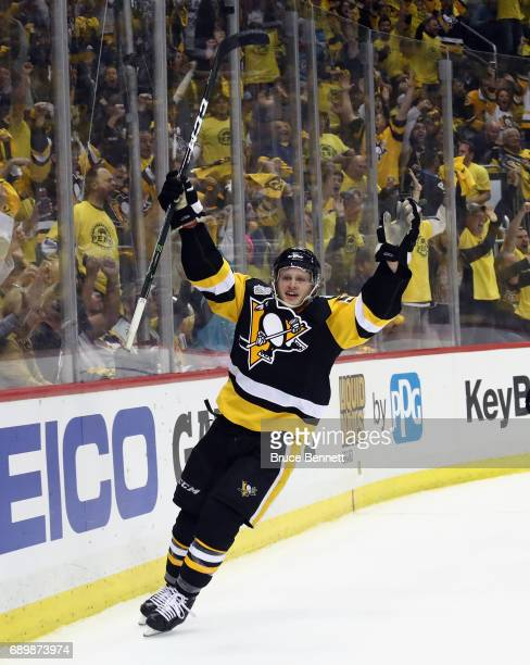 Jake Guentzel of the Pittsburgh Penguins reacts after scoring a goal during the third period in Game One of the 2017 NHL Stanley Cup Final against...