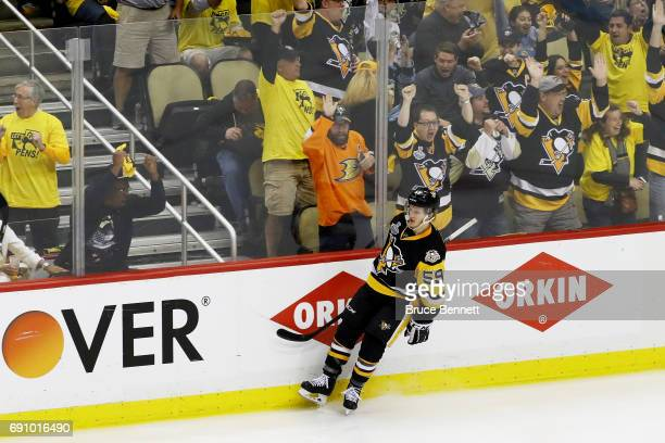 Jake Guentzel of the Pittsburgh Penguins reacts after scoring a goal during the third period in Game Two of the 2017 NHL Stanley Cup Final against...