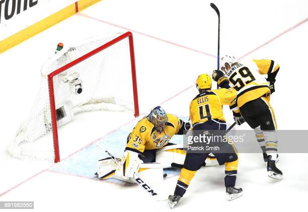 Jake Guentzel of the Pittsburgh Penguins scores a first period goal against Pekka Rinne of the Nashville Predators in Game Three of the 2017 NHL...