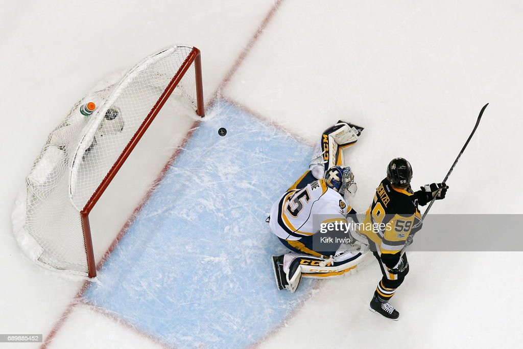 Jake Guentzel #59 of the Pittsburgh Penguins scores a goal past Pekka Rinne #35 of the Nashville Predators in Game One of the 2017 NHL Stanley Cup Final at PPG Paints Arena on May 29, 2017 in Pittsburgh, Pennsylvania.