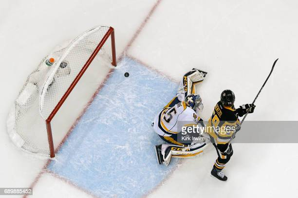 Jake Guentzel of the Pittsburgh Penguins scores a goal past Pekka Rinne of the Nashville Predators in Game One of the 2017 NHL Stanley Cup Final at...