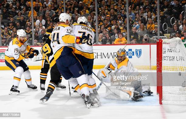 Jake Guentzel of the Pittsburgh Penguins scores past Juuse Saros of the Nashville Predators in the first period at PPG Paints Arena on October 7 2017...