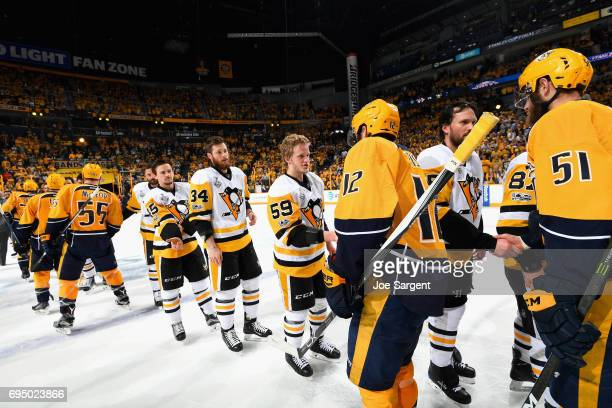 Jake Guentzel of the Pittsburgh Penguins shakes hands with Mike Fisher of the Nashville Predators after the Penguins defeated the Predators 20 to win...