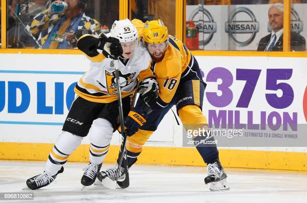 Jake Guentzel of the Pittsburgh Penguins skates against James Neal of the Nashville Predators during Game Four of the 2017 NHL Stanley Cup Final at...