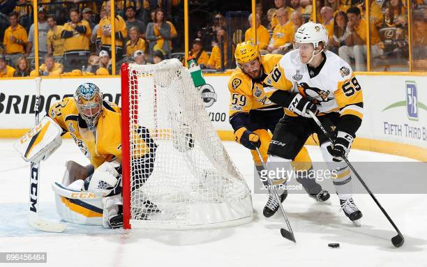Jake Guentzel of the Pittsburgh Penguins skates against Roman Josi and Pekka Rinne of the Nashville Predators during Game Three of the 2017 NHL...